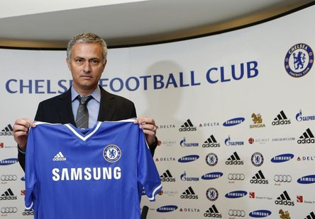 Newly reappointed Chelsea manager Jose Mourinho poses for photographers during a news conference at Stamford Bridge stadium in London June 1