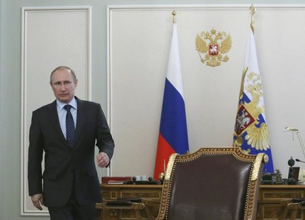 Russia's President Vladimir Putin arrives for a meeting with members of the government at the Novo-Ogaryovo state residence outside Moscow,