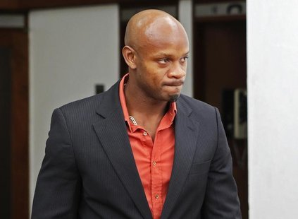 Jamaica's Olympic runner Asafa Powell, who tested positive for doping at the Jamaican Championships in 2013, takes a lunch break on the firs