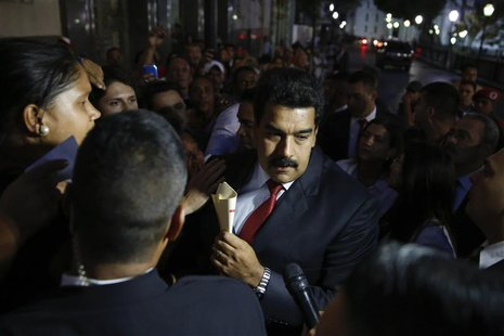Venezuela's President Nicolas Maduro (C) greets supporters after his meeting with representatives of the Venezuelan coalition of opposition