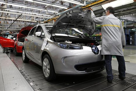 An employee works on a Renault Zoe electric car on the production line at the Renault automobile factory in Flins, west of Paris, May 28, 20