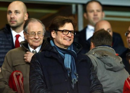 British actor Colin Firth attends the Champions League round of 16 first leg soccer match between Arsenal and Bayern Munich at the Emirates