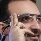 Developer Maximiliano Firtman wears the prototype device Google Glass before a news conference ahead of the 2013 RigaComm event in Riga Nove