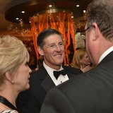 Citigroup CEO Michael Corbat (C) chats with Thomson Reuters CEO Jim Smith and his wife Pam Kushmerick at the Thomson Reuters reception prior