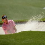 Spain's Miguel Angel Jimenez hits from the sand on the 18th hole during the first round of the 2014 Masters golf tournament at the Augusta N