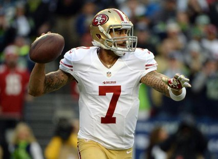 Jan 19, 2014; Seattle, WA, USA; San Francisco 49ers quarterback Colin Kaepernick (7) drops back to pass against the Seattle Seahawks during