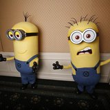 "Two life-size minion characters wait for actor Steve Carell to arrive while promoting his upcoming movie ""Despicable Me 2"" in Los Angeles, C"
