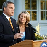 Three-term Republican Connecticut Governor John Rowland (L), with his wife Patty at his side, makes a televised address from the governor's