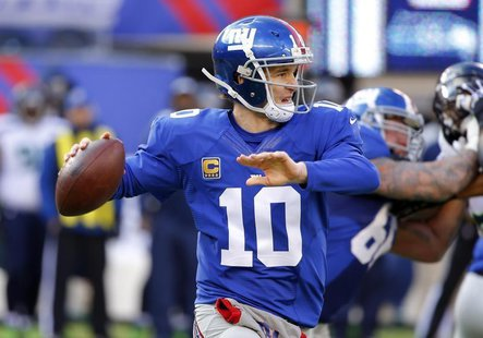 Dec 15, 2013; East Rutherford, NJ, USA; New York Giants quarterback Eli Manning (10) throws a pass during the first half against the Seattle