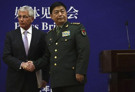 U.S. Secretary of Defense Chuck Hagel (L) shakes hands with Chinese Minister of Defense Chang Wanquan at the end of a joint news conference
