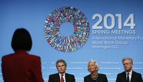 International Monetary Fund (IMF) Managing Director Christine Lagarde (2nd R) takes a question during a news conference in Washington April