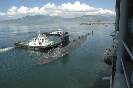 The Virginia-class submarine USS Hawaii pulls alongside the submarine tender USS Frank Cable in Subic Bay, in this September 6, 2012 handout