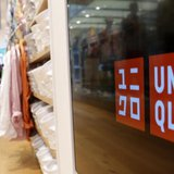 Shoppers walk at Fast Retailing Co's Uniqlo casual fashion chain store in Tokyo April 10, 2013. REUTERS/Yuya Shino