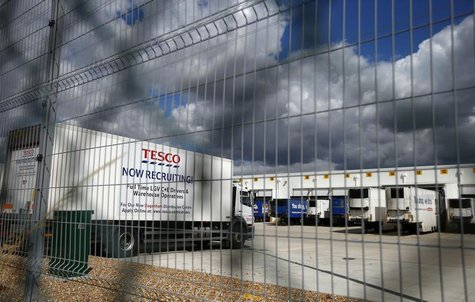 A lorry with job advertisements on its side is seen parked at Tesco's new distribution centre in Dagenham, east London August 12, 2013. REUT