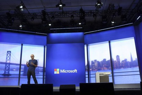 "Microsoft CEO Satya Nadella gestures during his keynote address at the company's ""build"" conference in San Francisco, California April 2, 20"