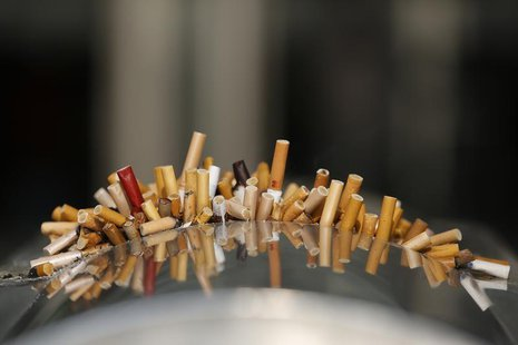 Extinguished cigarettes are seen in an ashtray at the Shanghai Railway Station December 23, 2013. REUTERS/Aly Song