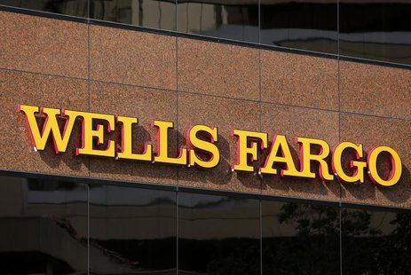 The logo on a Wells Fargo bank building is seen in downtown San Diego, California March 18, 2014. REUTERS/Mike Blake