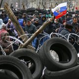 Pro-Russia protesters gather in front of a barricade outside a regional government building in Donetsk, in eastern Ukraine April 11, 2014. R