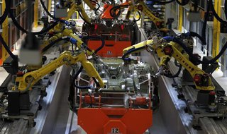 Robotic Arms work on the underside of the 2015 Chrysler 200 vehicle at the Sterling Heights Assembly Plant in Sterling Heights, Michigan Mar