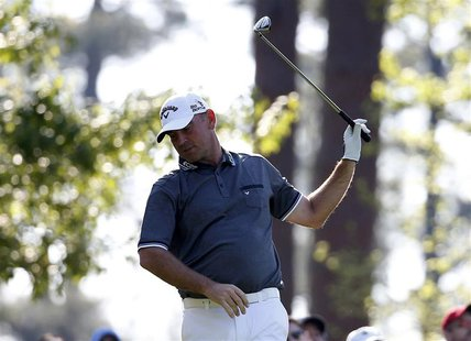 Denmark's Thomas Bjorn reacts after his tee shot on the fourth hole during the second round of the Masters golf tournament at the Augusta Na