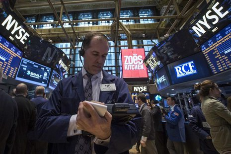Traders work on the floor of the New York Stock Exchange April 11, 2014. REUTERS/Brendan McDermid