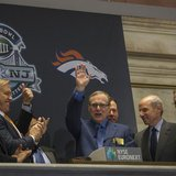 Seattle Seahawks owner and Microsoft co-founder Paul Allen (C) waves to the trading floor after ringing the opening bell at the New York Sto