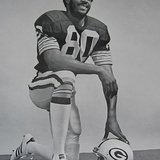 James Lofton on the Green Bay Packers By National Football League / Green Bay Packers (ebay.com, front of photo back of photo) [Public domain], via Wikimedia Commons