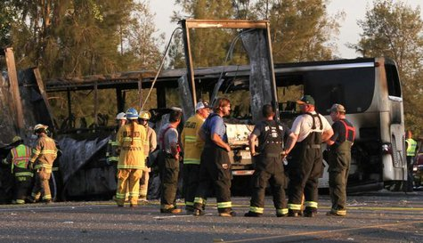 Rescue workers, police and firefighters survey the scene where a truck and a tour bus collided on Interstate 5 near Highway 32 near Orland, California, April 10, 2014. MANDATORY CREDIT  CREDIT: REUTERS/GREG BARNETTE/RECORD SEARCHLIGHT
