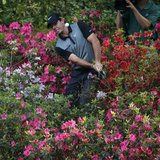 Northern Ireland's Rory McIlroy hits from the azaleas on the 13th hole during the second round of the Masters golf tournament at the Augusta