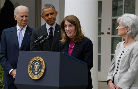 U.S. President Barack Obama (2nd L) listens after announcing Director of the Office of Management and Budget Sylvia Mathews Burwell (2nd R)