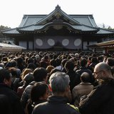People wait to offer New Year prayers at Yasukuni Shrine in Tokyo January 1, 2014. REUTERS/Yuya Shino