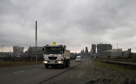 Trucks leave an Anglo American Platinum (AMPLATS) processing plant near Rustenburg in this October 12, 2012 file photo. REUTERS/Mike Hutchin
