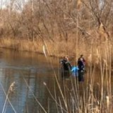 Divers in the water at Lake Charles, where the body was found on April 6th.