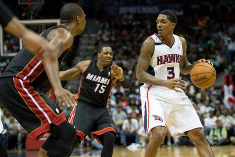 Apr 12, 2014; Atlanta, GA, USA; Miami Heat guard Mario Chalmers (15) defends Atlanta Hawks guard Louis Williams (3) during the fourth quarte