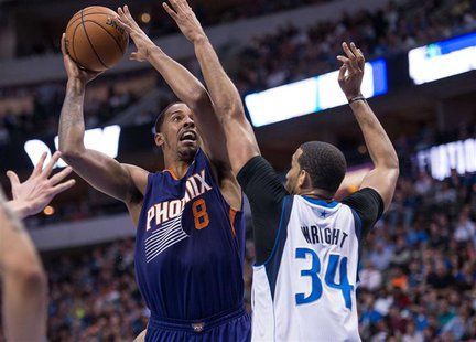 Apr 12, 2014; Dallas, TX, USA; Dallas Mavericks forward Brandan Wright (34) defends against Phoenix Suns forward Channing Frye (8) during th