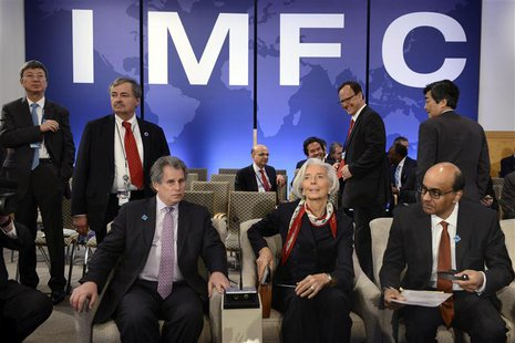 IMF Managing Director Christine Lagarde (C) takes her seat as she joins IMF First Deputy Managing Director David Lipton (L) and Singapore's
