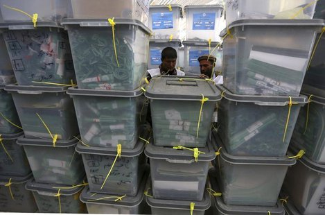 Afghan electoral workers sort ballot boxes at a counting centre in Kabul April 10, 2014. REUTERS/Omar Sobhani