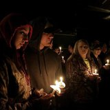 Members of communities affected by the Oso mudslide participate a candlelight vigil at the Community Center in Darrington, Washington April