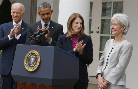 U.S. President Barack Obama (2nd L) applauds after announcing Director of the Office of Management and Budget Sylvia Mathews Burwell (2nd R)