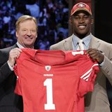 Defensive end Aldon Smith of the University of Missouri stands with NFL Commissioner Roger Goodell after being selected as the seventh overa