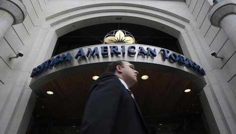 A man walks past the British American Tobacco offices in London May 6, 2009. REUTERS/Luke MacGregor