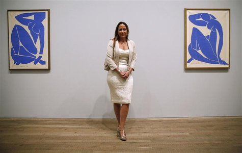 "Sophie Matisse, great granddaughter of Henri Matisse, poses with his artwork ""Blue Nude III"" (Nu Bleu III) (L) and ""Blue Nude II"" (Nu Bleu I"