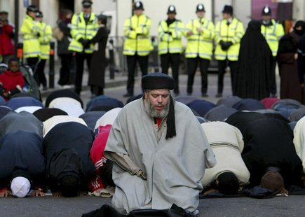 Muslim cleric, Abu Hamza al-Masri, is seen leading prayers outside the North London Central Mosque, in Finsbury Park, north London in this J