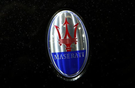 The company logo is seen on the bonnet of a Maserati car during the media day ahead of the 84th Geneva Motor Show at the Palexpo Arena in Ge