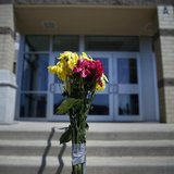 Flowers are seen outside the Franklin Regional High School in Murrysville, Pennsylvania April 10, 2014. REUTERS/Shannon Stapleton