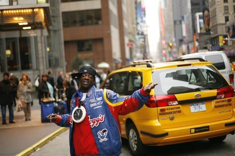 Rapper Flavor Flav walks down the street in New York March 16, 2009. REUTERS/Lucas Jackson