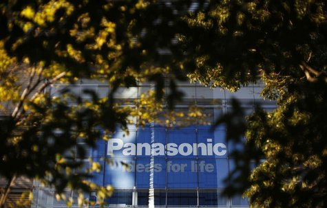 The logo of Panasonic Corp is seen behind trees outside its showroom in Tokyo November 14, 2012. REUTERS/Toru Hanai