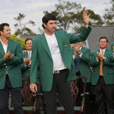 Masters champion Bubba Watson of the U.S. waves after being presented the traditional green jacket by last year's champion Adam Scott of Australia (L) after the final round of the Masters golf More... CREDIT: REUTERS/MIKE BLAKE