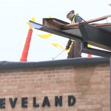 Crews repair part of the roof of Cleveland Elementary School after a storm damaged the region on April 13, 2014. (Photo from: YouTube).