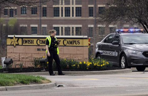 An Overland Park Kansas police officer guards the entrance to the scene of a shooting at the Jewish Community Center of Greater Kansas City in Overland Park, Kansas April 13, 2014.  CREDIT: REUTERS/DAVE KAUP